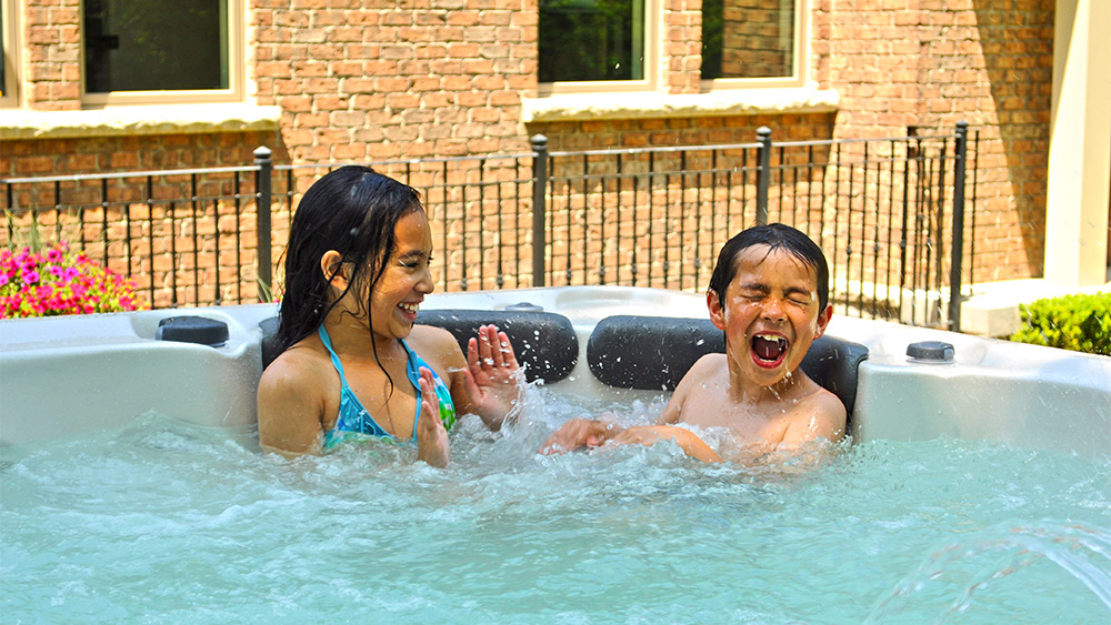 Children playing in hot tub